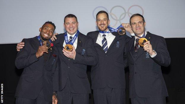 Fearon, Tasker, Benson and Jackson celebrate with their medals at long last