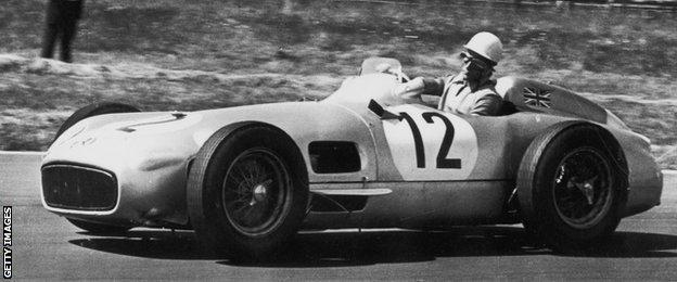 Stirling Moss in a Mercedes at the 1955 British Grand Prix