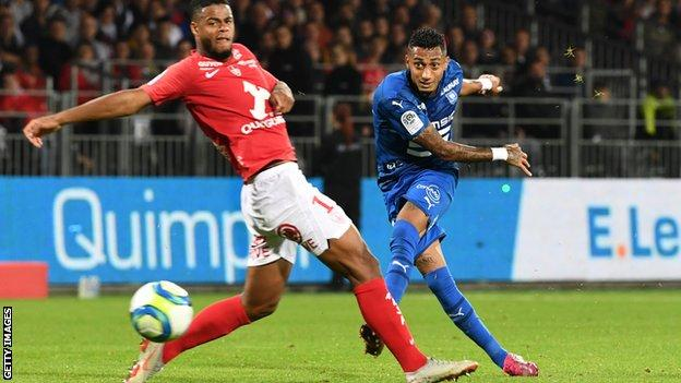 Raphinha shoots at goal during his time at Rennes