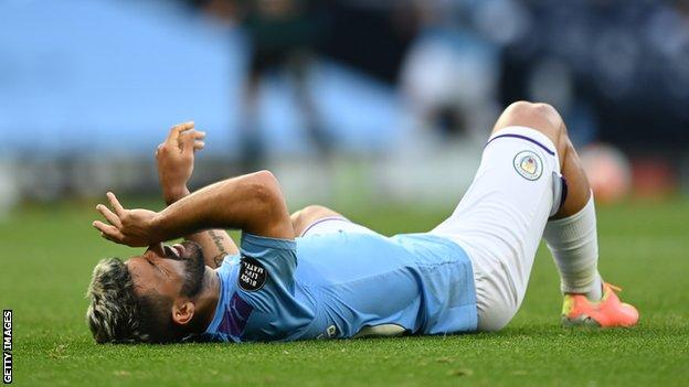 Manchester City striker Sergio Aguero lies down after injuring his knee against Burnley in June