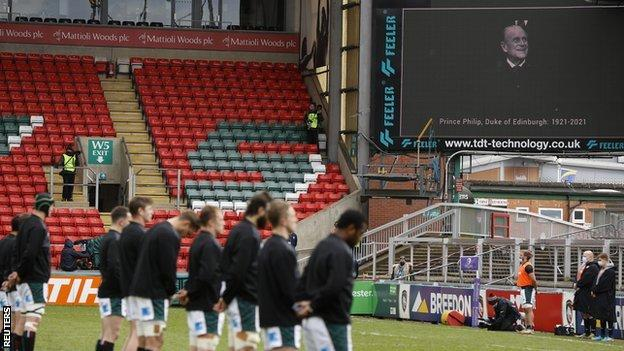 General view of rugby players during a two minute silence for Prince Philip