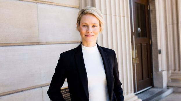 Madeleine Pape dressed in formal clothes