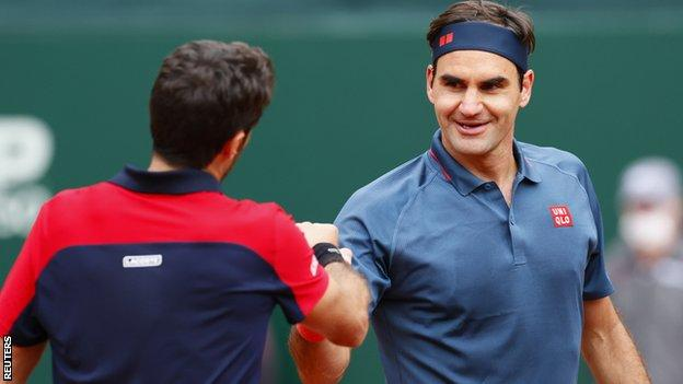 Roger Federer shakes hands with Pablo Andujar at the net after their match in Geneva