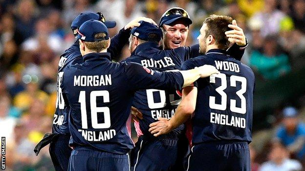Jos Buttler and his England team-mate celebrate the wicket of Australia captain Steve Smith