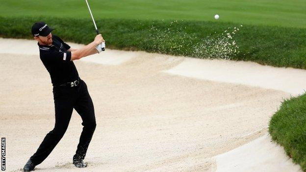 Jimmy Walker chips in from the bunker on the 10th hole