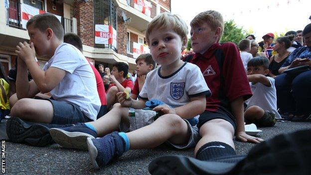 Young England fans watch the team against Colombia