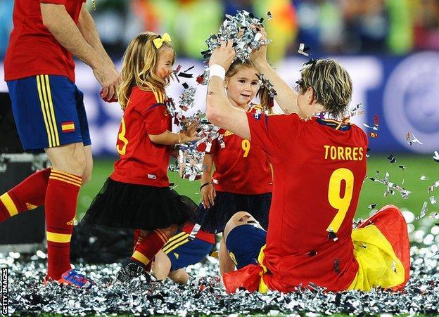 Torres celebrates with his children