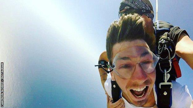 Cameron Norrie skydiving