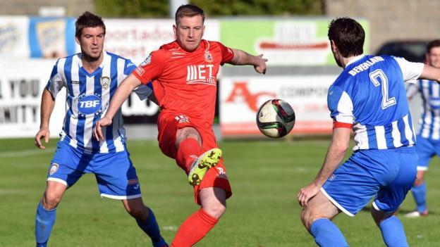 Coleraine defenders Steven Douglas and Howard Beverland close in on Portadown striker Mark McAllister at Shamrock Park