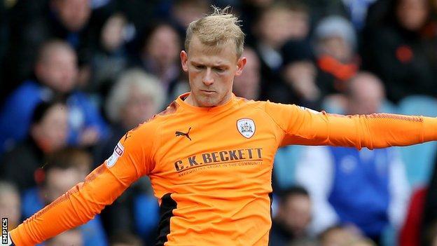 Barnsley keeper Adam Davies clears the ball