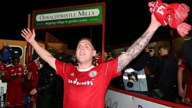 Billy Kee celebrates Accrington's promotion to League One in April 2018