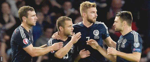 Shaun Maloney is congratulated on helping Scotland draw level against Germany