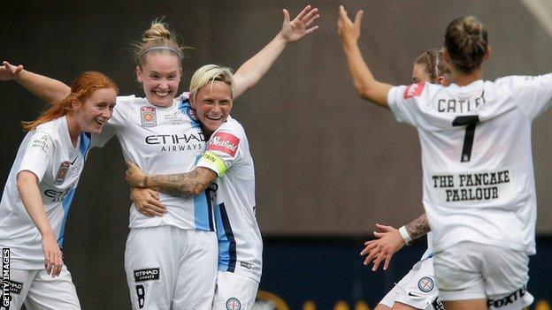 Kim Little (second left) celebrates scoring for Melbourne City in the W-League Grand Final against Sydney