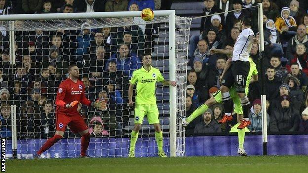 Bradley Johnson heads in Derby's first-half equaliser against Brighton