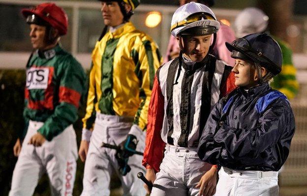 Hollie Doyle, right, with jockeys at Kempton