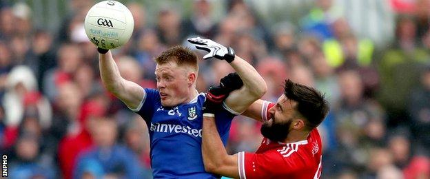Monaghan's Ryan McAnespie and Tiernan McCann of Tyrone battle for possession