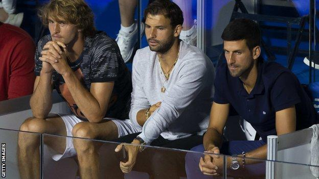 donald trump news Grigor Dmitrov seated next to Novak Djokovic