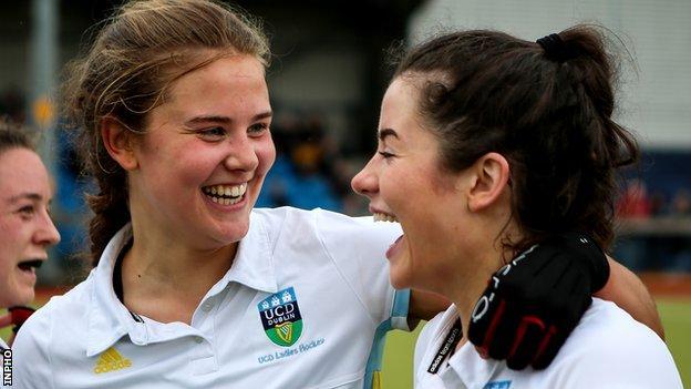 UCD players celebrate their Irish Cup final success over Pegasus