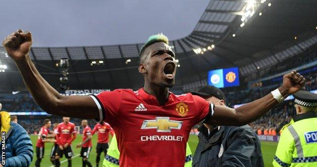Paul Pogba celebrates Manchester United's win at Etihad Stadium in April