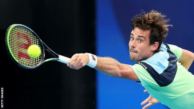 Guido Pella returns a serve at the ATP Cup in 2020