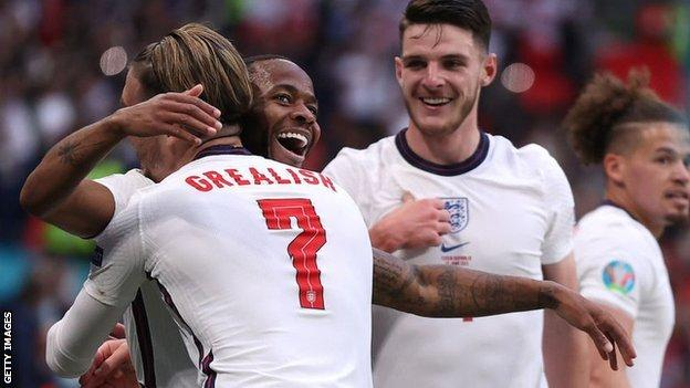 England players celebrate their opener