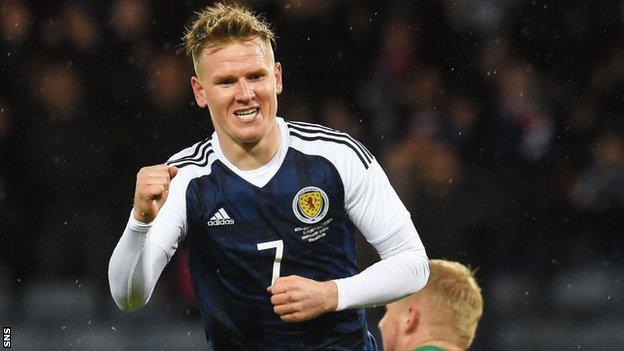 Matt Ritchie celebrates his winning goal for Scotland against Denmark in March