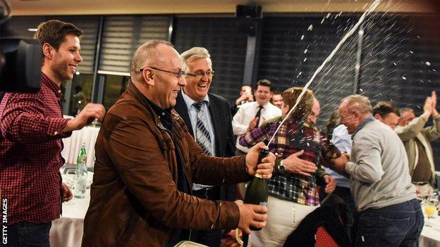 """Officials of the Football Federation of Kosovo celebrate in Pristina on May 13, 2016 after the FIFA Congress granted membership to Kosovo""""s Football Federation"""