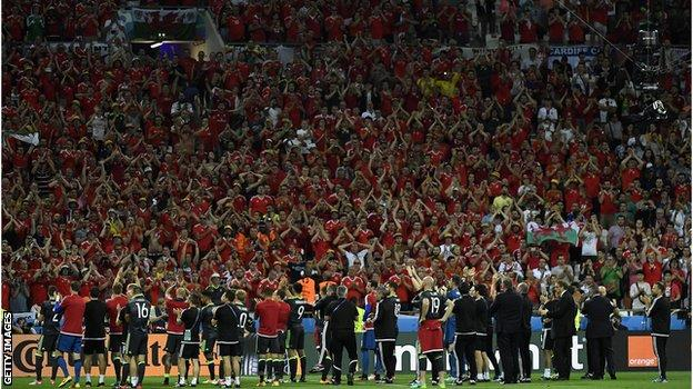 The Welsh team thank the fans inside the stadium in Lyon