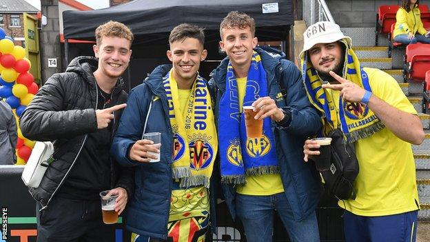 Visiting Villarreal fans enjoy the hospitality at Crusaders' Seaview ground in north Belfast