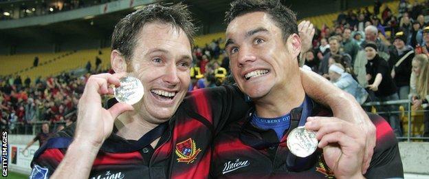 Andrew Mehrtens (left) and Dan Carter celebrate Canterbury's NPC final win in 2004