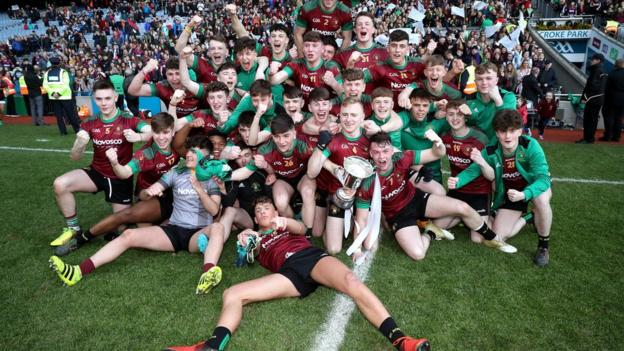 The celebrations begin for St Ronan's after they added the Hogan Cup to their MacRory Cup success