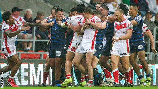 Wigan and St Helens players clash in their Super League meeting at the Totally Wicked Stadium