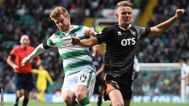 Celtic's Stuart Armstrong (left) battles for the ball against Kilmarnock's Mark O'Hara