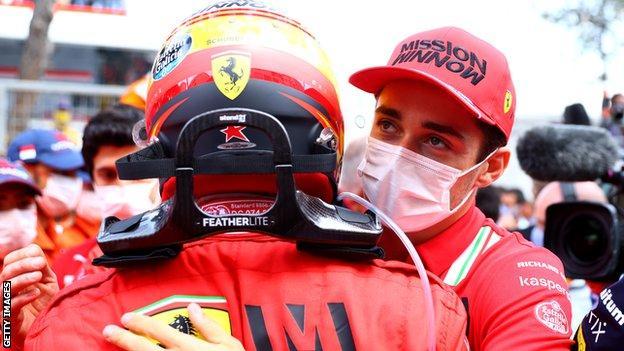 Charles Leclerc congratulates team-mate Carlos Saniz