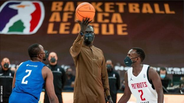 BAL president Amadou Gallo Fall performs the ceremonial tip-off of the inaugural tournament on 16 May