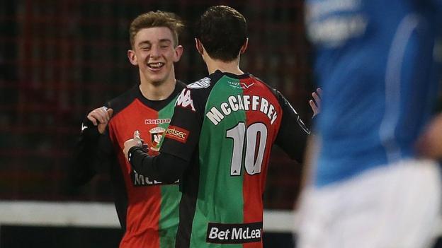 Glentoran goalscorer Jonathan Smith celebrates with team-mate Fra McCaffrey during the 1-1 draw with Dungannon
