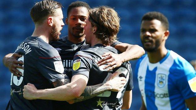 Brentford's Mads Sorensen celebrates scoring with Pontus Jansson and Ethan Pinnock