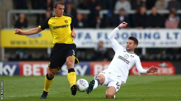 Burton's Stephen Warnock (left) and Oliver Norwood of Fulham