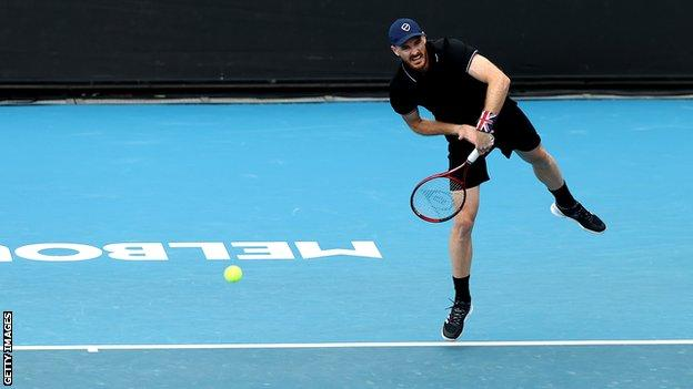 Jamie Murray serves in an Australian Open match