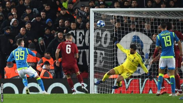 Liverpool keeper Alisson saves from Napoli's Poland forward Arkadiusz Milik during a Champions League game