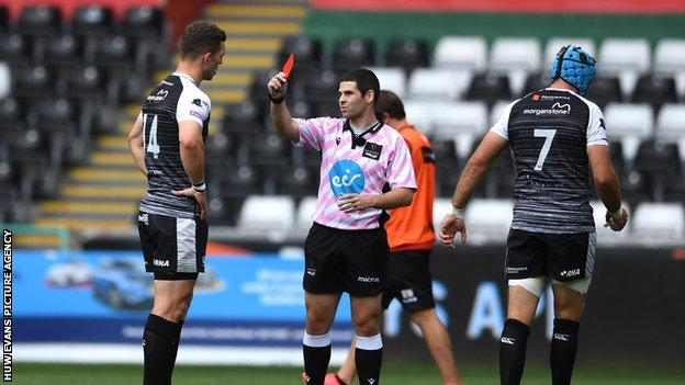 George North is shown a red card by referee Adam Jones in the Ospreys 20-20 draw with Dragons