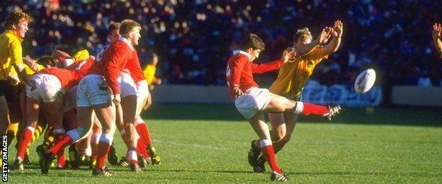 Wales' scrum-half Robert Jones clears against Australia