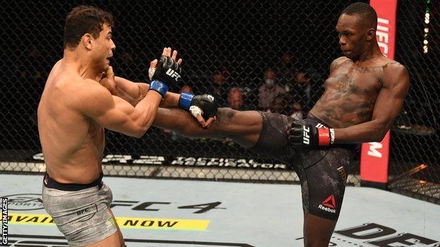 Nigeria-born Israel Adesanya (right) lands a kick on Paulo Costa at UFC 253