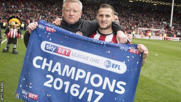 Sheffield United manager Chris Wilder and Billy Sharp celebrate the Blades promotion for League One