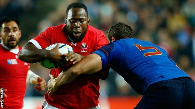Djustice Sears-Duru of Canada is tackled by Yoann Maestri of France