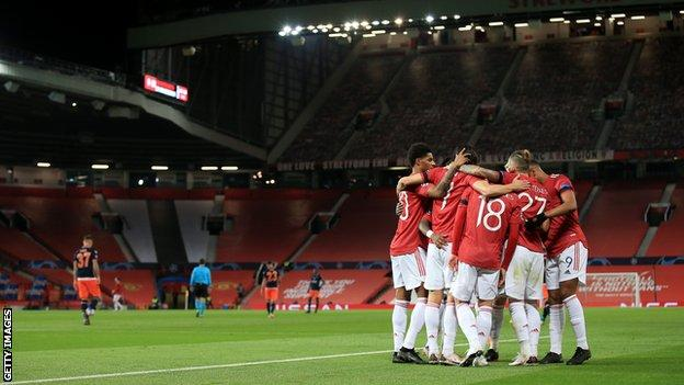Manchester United players celebrate at Old Trafford