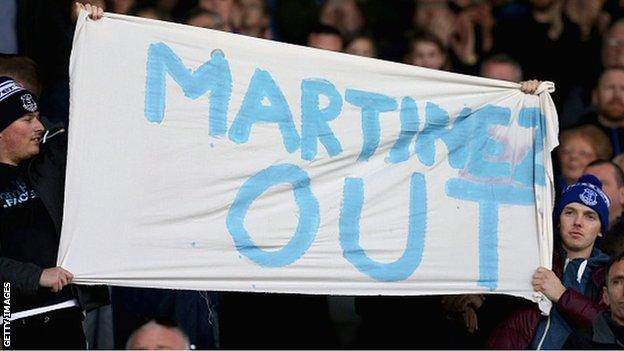 Everton fans with a banner aimed at manager Roberto Martinez