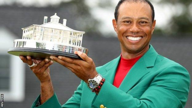 Tiger Woods with Masters trophy in 2019