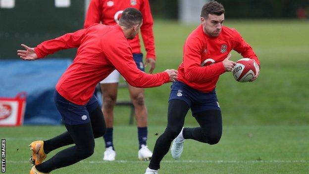 George Ford runs in training