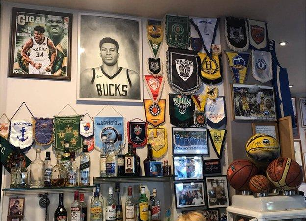 A supporters' bar in Athens where a Giannis portrait takes pride of place